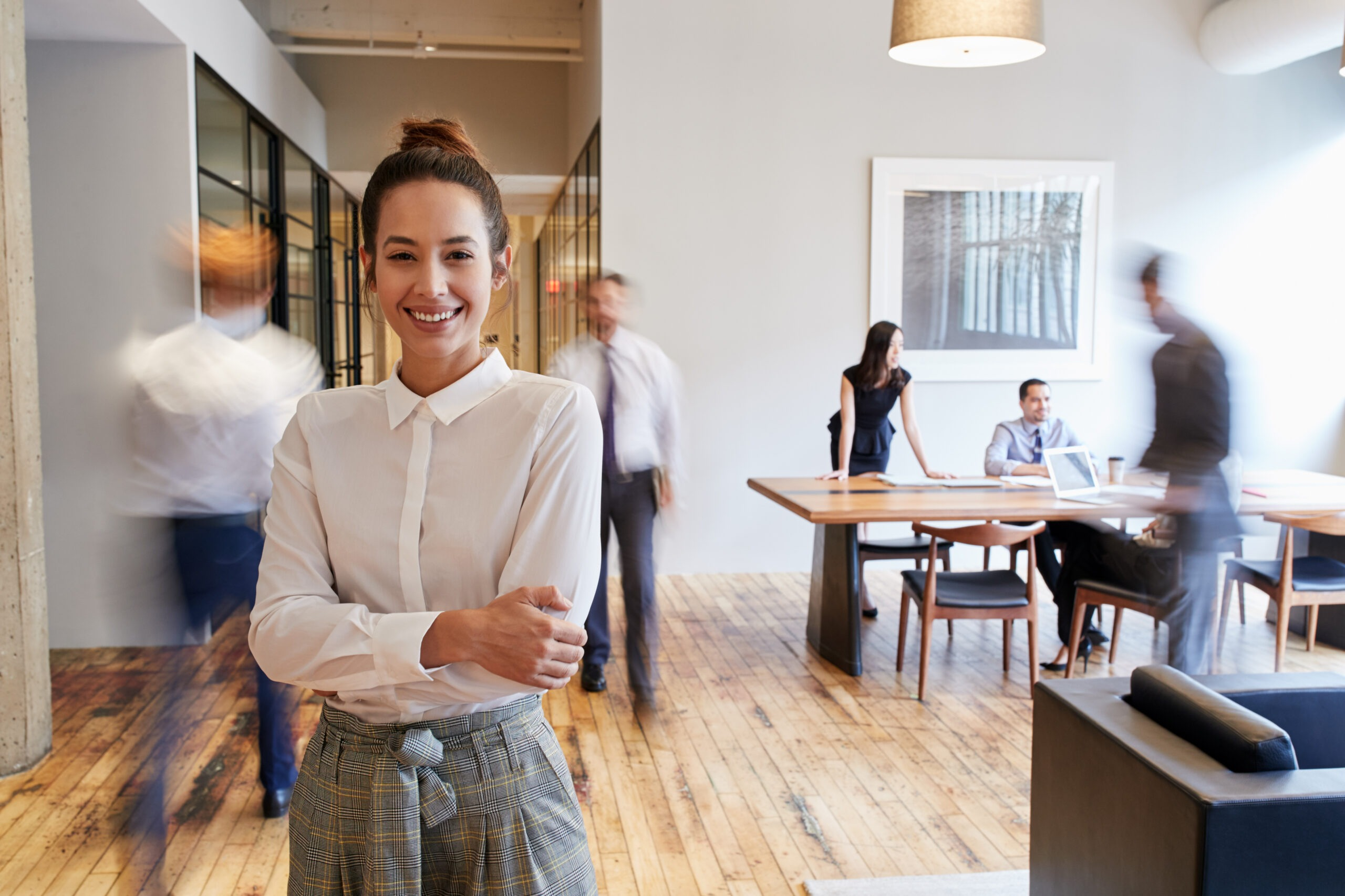 Portrait,Of,Young,White,Woman,In,A,Busy,Modern,Workplace
